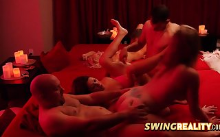 Swinger couples are having a sinful orgy