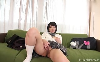 Asian GF Hitomi Kanami nigh teacher unvarying masturbates upon a vibrator